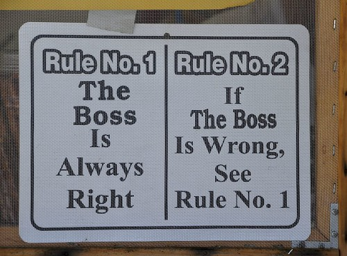 "Sign that says ""rule no 1 - the boss is always right rule no 2 - if the boss is wrong,  see rule no 1"""