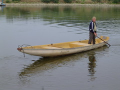 canoe(0.0), watercraft rowing(0.0), boats and boating--equipment and supplies(1.0), vehicle(1.0), skiff(1.0), boating(1.0), watercraft(1.0), oar(1.0), boat(1.0), paddle(1.0),