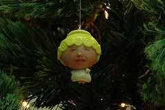 flower(0.0), branch(0.0), garden gnome(0.0), lawn ornament(0.0), forest(0.0), jungle(0.0), statue(0.0), leaf(1.0), tree(1.0), plant(1.0), christmas decoration(1.0), green(1.0), christmas tree(1.0),