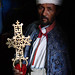 Priest with processional cross, Bet Meskel, Lalibela