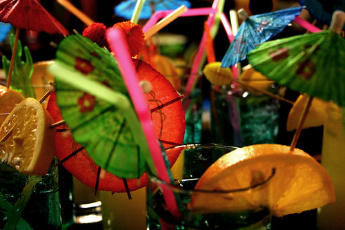Drinks with umbrellas and straws