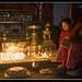 oillamps in a temple in Kathmandu by Dick Verton