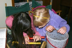 Sophia and Hannah Measuring a Worm