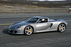 automobile(1.0), vehicle(1.0), performance car(1.0), automotive design(1.0), porsche(1.0), porsche carrera gt(1.0), land vehicle(1.0), luxury vehicle(1.0), supercar(1.0), sports car(1.0),
