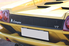 lamborghini gallardo(0.0), ferrari testarossa(0.0), race car(1.0), automobile(1.0), automotive exterior(1.0), lamborghini(1.0), yellow(1.0), vehicle(1.0), performance car(1.0), automotive design(1.0), lamborghini(1.0), bumper(1.0), land vehicle(1.0), luxury vehicle(1.0), lamborghini diablo(1.0),