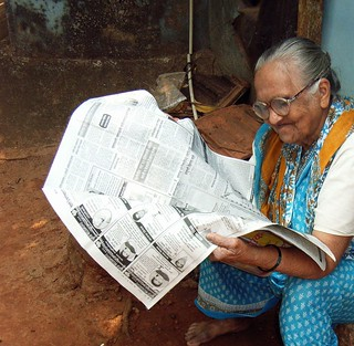 old woman reading the papers