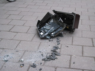 Smashed tv-set on the pavement | by Imbecillsallad