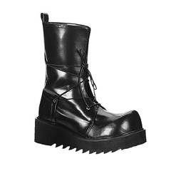 outdoor shoe(0.0), motorcycle boot(0.0), limb(0.0), human body(0.0), snow boot(1.0), footwear(1.0), shoe(1.0), leather(1.0), boot(1.0),