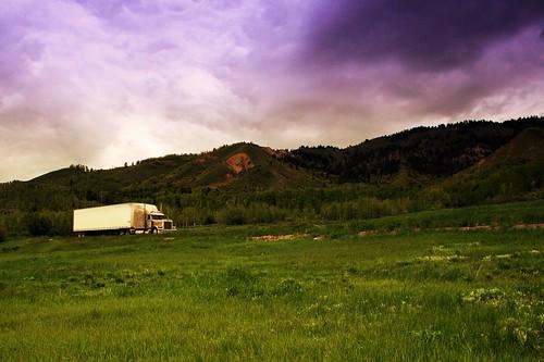 tractor storm mountains green clouds truck spring dry reservoir semi idaho trailer van palisades peterbilt 379