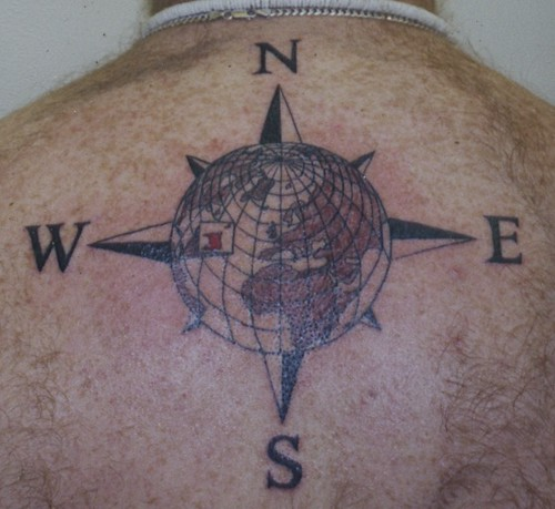 Tattoo Design: tattoo of the world with compass rose surround done ...