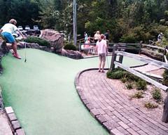 backyard(0.0), sports(1.0), recreation(1.0), outdoor recreation(1.0), leisure(1.0), miniature golf(1.0), walkway(1.0),