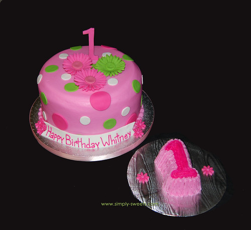 pink and green gerber daisies first birthday cake