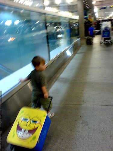nick and sequoia pulling their suitcases to baggage claim at PDX   DSC01282