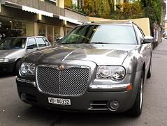 automobile(1.0), automotive exterior(1.0), executive car(1.0), vehicle(1.0), mid-size car(1.0), chrysler 300(1.0), chrysler(1.0), land vehicle(1.0), luxury vehicle(1.0),