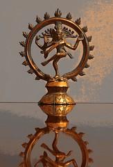 light fixture(0.0), wood(0.0), menorah(0.0), candle holder(0.0), lighting(0.0), carving(1.0), metal(1.0), iron(1.0), bronze(1.0),