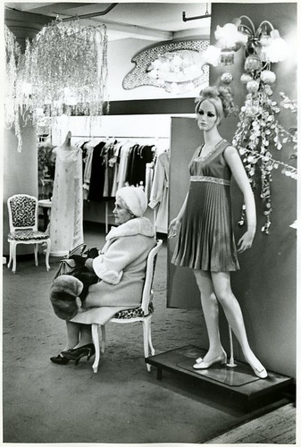 [WOMAN SITTING IN STORE]