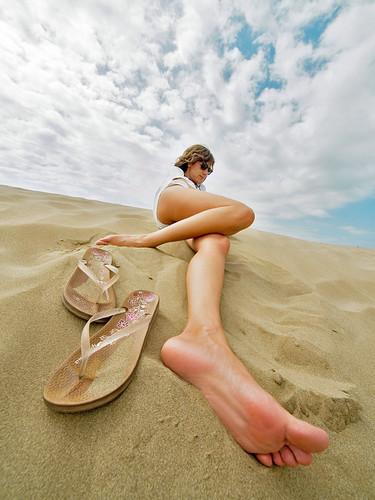portrait beach foot reflex sand bravo funny olympus flipflop thongs anatomy highkey resting angular ultrawide zuiko layingdown e500 uro 714mm retofez100413 gettyimagesspainq1