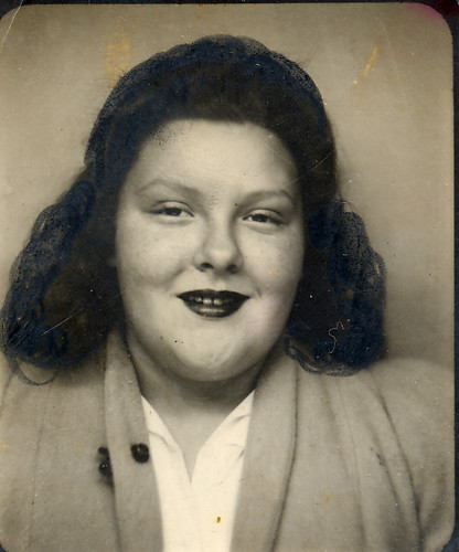 Lady in a photobooth