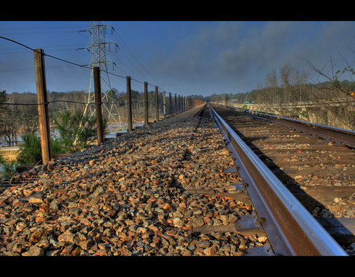 wood railroad travel bridge blue sky green tower lines metal stone train point vanishingpoint rust rocks stones steel horizon tracks carolina pow radiohead electrical vanishing hdr midlands columbiasc