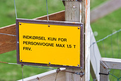 This is one of the very few signs in Danish language in the Faroe Islands. I guess, it has to do with the Danish authority over the lighthouses, if there still is one...  This also means, that all signs in the Faroes are in Faroese, and if they are bilingual, they are in English instead of Danish.