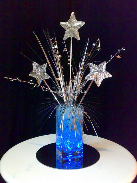 Glacier centerpiece blue with silver stars suspended inside vase and ...