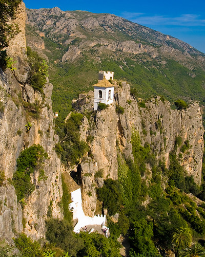 The tunnel entrance to the fortified Moorish village of Guadalest and above it the Bell and Watch Towers