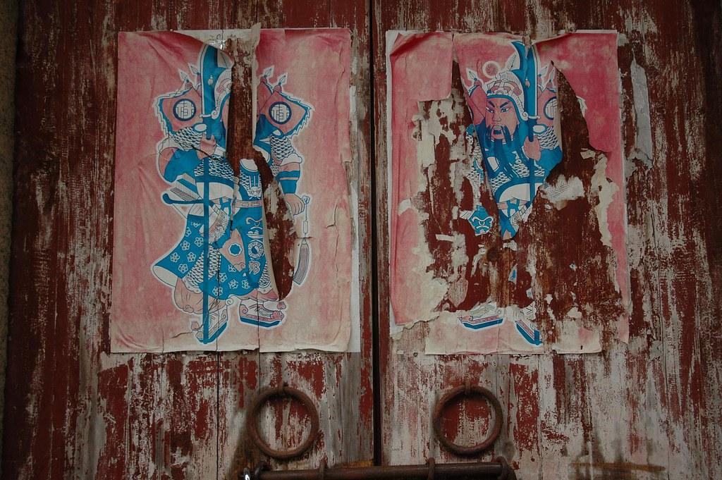 Torn Posters on Door