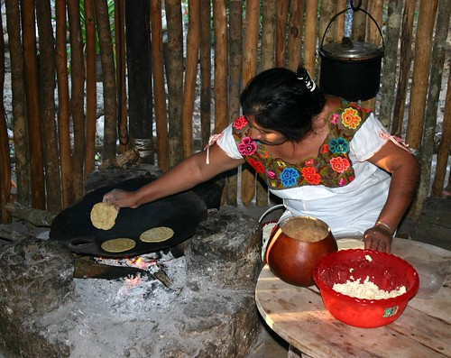 Native woman preparing maize tortillas