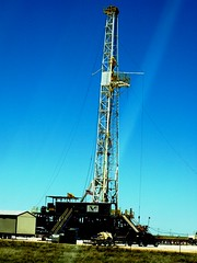 jackup rig(0.0), mast(0.0), transmission tower(0.0), construction equipment(0.0), oil field(0.0), vehicle(1.0), drilling rig(1.0), tower(1.0),