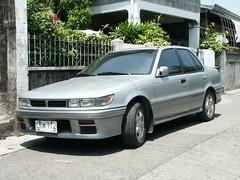 automobile, automotive exterior, vehicle, mitsubishi, compact car, bumper, sedan, land vehicle,