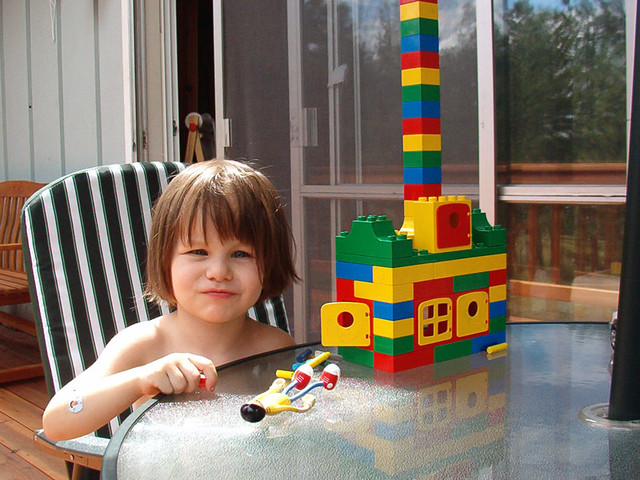 Building with DUPLO bricks on the deck