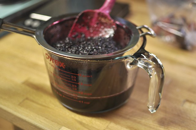 straining black raspberry syrup