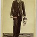 Trick photo, decapitated man with bloody knife, holding his head by George Eastman House