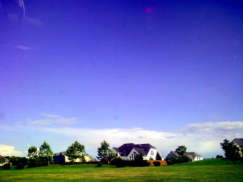 cameraphone sky clouds suburbia takenwhiledriving mcmansion myobsession postcardsfromnowhere neougly pa113 frameismorethantwothirdsempty