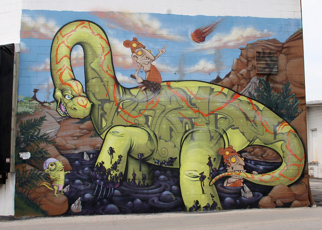 Caveman And Dinosaurs : Foxx equipment mural dinosaurs and cavemen left panel