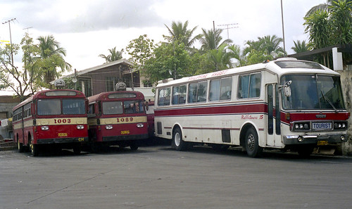 Philippine Rabbit buses CVD-567 (fleet No 1003) CVE-727 (fleet No 1089) Isuzu Coach NWX-697 (fleet No 15) bus terminal Tarlac Tarlac Philippines.