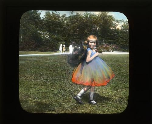 Girl in butterfly or flower costume