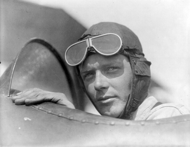Charles Lindbergh, wearing helmet with goggles up, in open cockpit of airplane at Lambert Field, St. Louis, Missouri