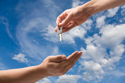Handing over keys on blue sky