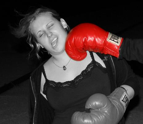 Girl getting knocked out by boxing glove.
