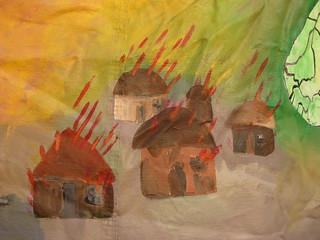 Burning village painting at encampment for Darfur