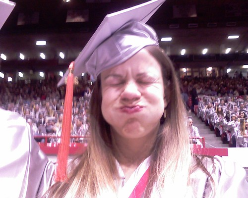 Girl making face at graduation.