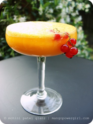a mango rum fizz topped with currants