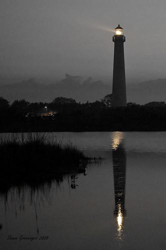 light sunset usa lighthouse house reflection tower water silhouette d50 evening newjersey nikon dusk nj capemaypoint capemay beacon delawarebay capemaylighthouse aplusphoto