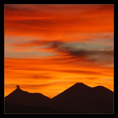 sunset sky orange clouds guatemala volcanoes potofgold theunforgettablepictures lesamisdupetitprince