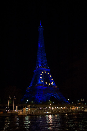 Night shot of Eiffel Tower (featuring 12 Golden Stars from the European Union), from The Seine, Paris, France