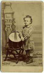 Portrait of Hine as small child standing by drum