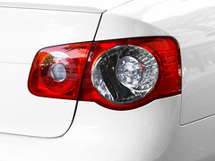 wheel(0.0), rim(0.0), grille(0.0), headlamp(0.0), automotive tail & brake light(1.0), automotive exterior(1.0), vehicle(1.0), automotive lighting(1.0), automotive design(1.0), light(1.0), bumper(1.0), luxury vehicle(1.0),