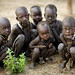 Karo kids waiting the white people wake up - Ethiopia by Eric Lafforgue