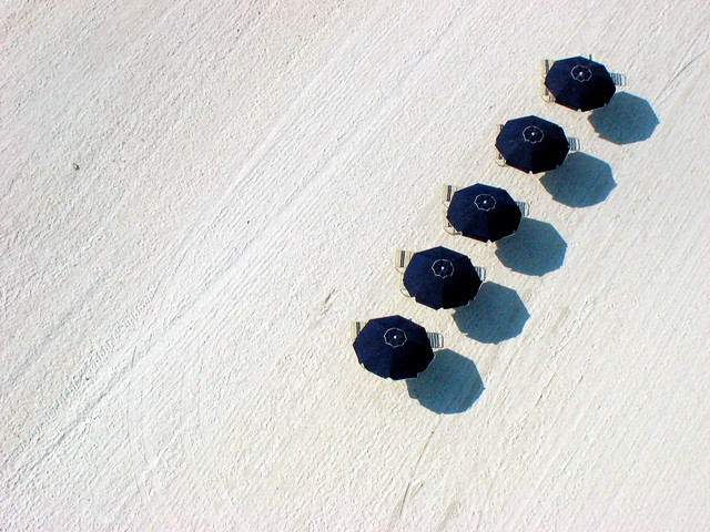Umbrella's on a Hot Dish of Sand.  Kite over Marco Island Florida USA - Umbrellas on a Hot Dish of Sand.